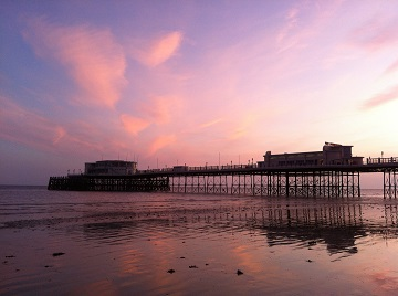 Worthing_Pier_at_sunset,_low_tide_small